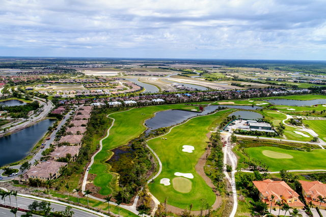 Florida Aerial Survey Technologies Aerial Survey Photograph of Golf Course with residential area surrounding and paved areas that are made using asphalt
